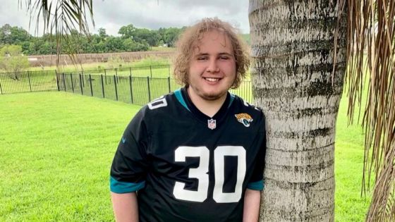 In this April 18, 2021 photo provided by Jennifer Sampson, her son Zach Sampson, 16, poses in his Florida yard. Sampson was hospitalized twice during the pandemic after feeling suicidal. Relentless months of social distancing, online schooling and ot
