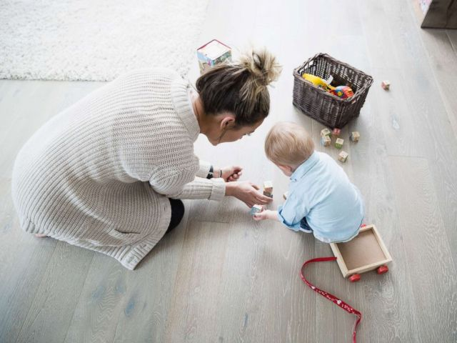 PHOTO: Mother and baby son playing with wood blocks in an undated stock photo.