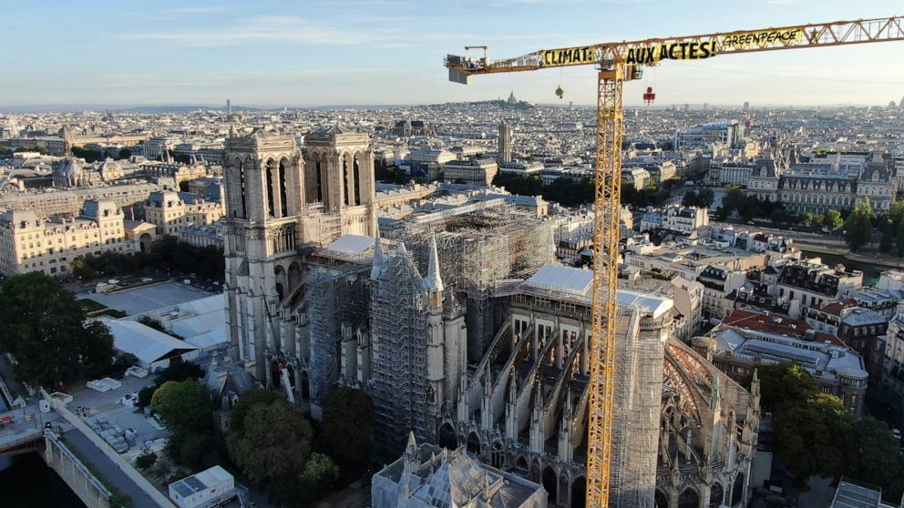 Climate activists protest from Notre Dame Cathedral crane thumbnail