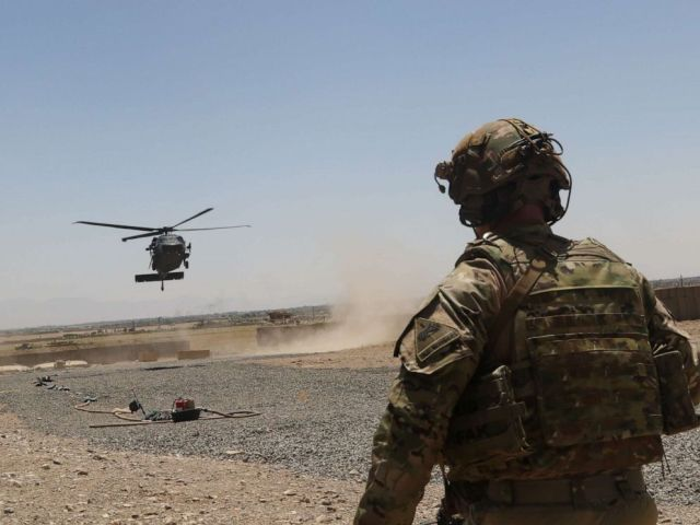 PHOTO: A Soldier watches as a UH-60 Blackhawk Helicopter prepares to land during an advise and assistance mission in southeastern Afghanistan, Aug. 4, 2019.