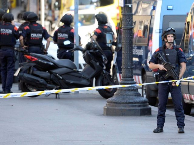 PHOTO: Armed policemen stand in a cordoned off area after a van plowed into a crowd on the citys famous Las Ramblas boulevard, in Barcelona, Aug. 17, 2017.