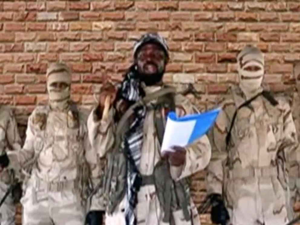 PHOTO: The leader of one of Boko Harams factions, Abubakar Shekau, speaks in front of guards in an unknown location in Nigeria in this still image taken from an undated video obtained on Jan. 15, 2018.
