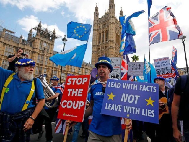 PHOTO: Anti-Brexit protesters march outside the Houses of Parliament in central London on September 3, 2019.