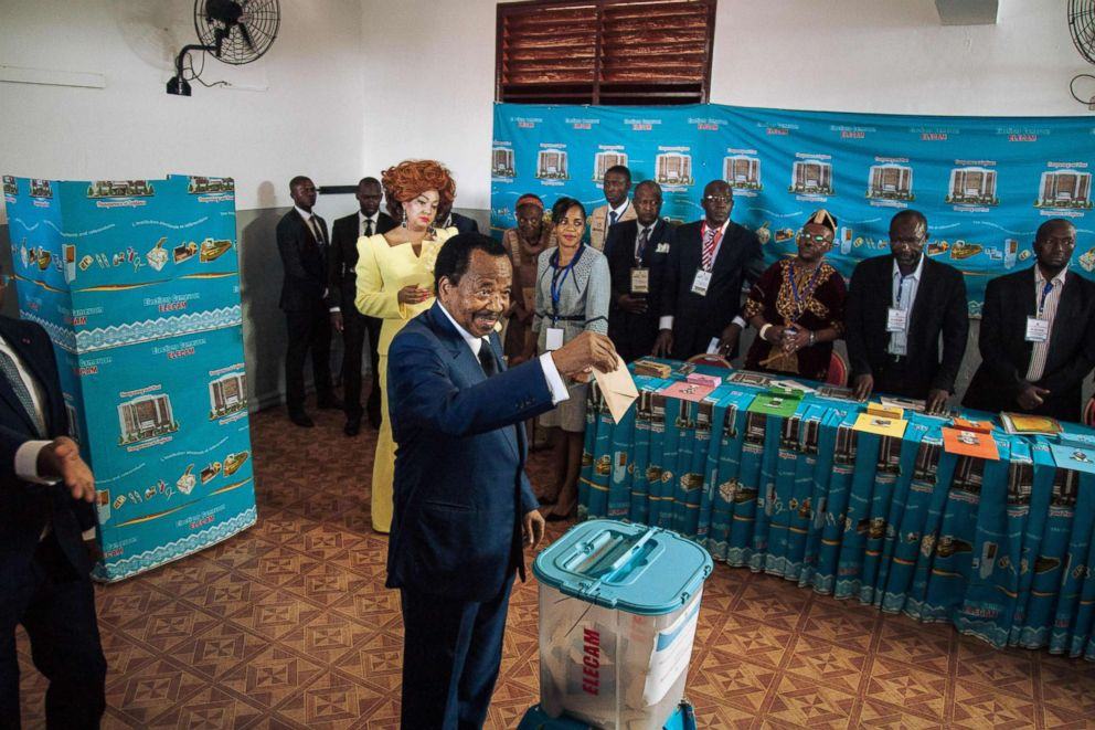 PHOTO: Cameroons incumbent President Paul Biya casts his ballot as his wife Chantal looks on in the polling station during Cameroons presidential election, Oct. 7, 2018.