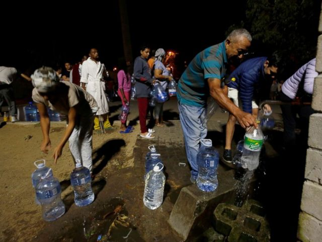 PHOTO: People queue to collect water from a spring in the Newlands suburb as fears over the citys water crisis grow in Cape Town, South Africa, Jan. 25, 2018.
