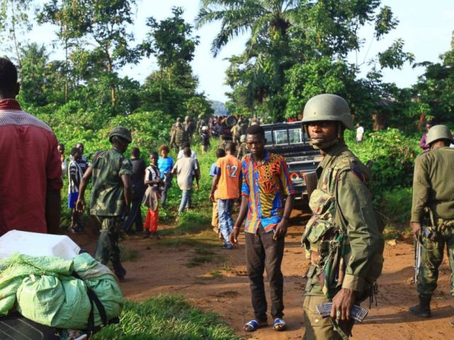 PHOTO: Patrols of Congolese soldiers in an area where civilians were killed by Allied Democratic Alliance rebels in Beni (eastern Congo) on 5 October 2018.