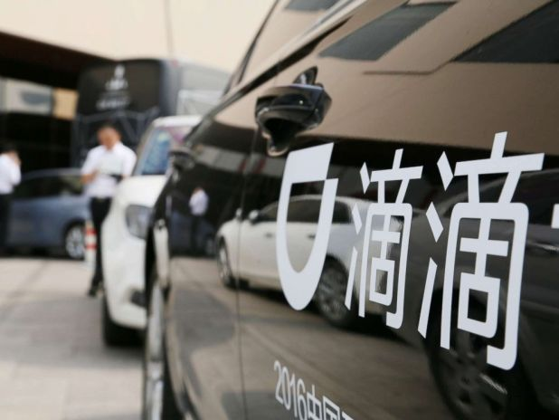PHOTO: A Didi sign is seen on a car during the China Internet Conference in Beijing, China in this file photo, June 21, 2016.