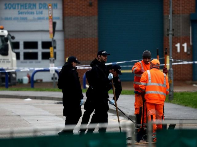 PHOTO: Police officers inspect a drain at the scene where bodies were discovered in a lorry container, in Grays, Essex, Britain October 24, 2019.
