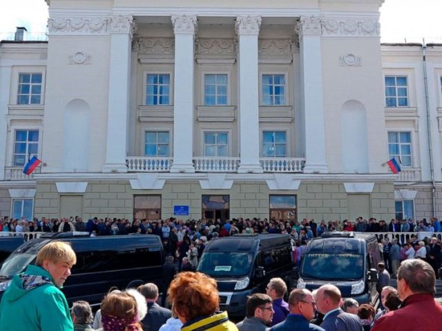 PHOTO: In this grab taken from a footage provided by the Russian State Atomic Energy Corporation ROSATOM press service, people gather for the funerals of five Russian nuclear engineers killed by a rocket explosion in Sarov.