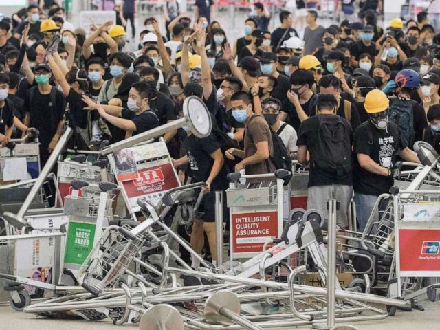 PHOTO: Demonstrators form a barricade as they clash with riot police at Hong Kong International Airport, Aug. 13, 2019.