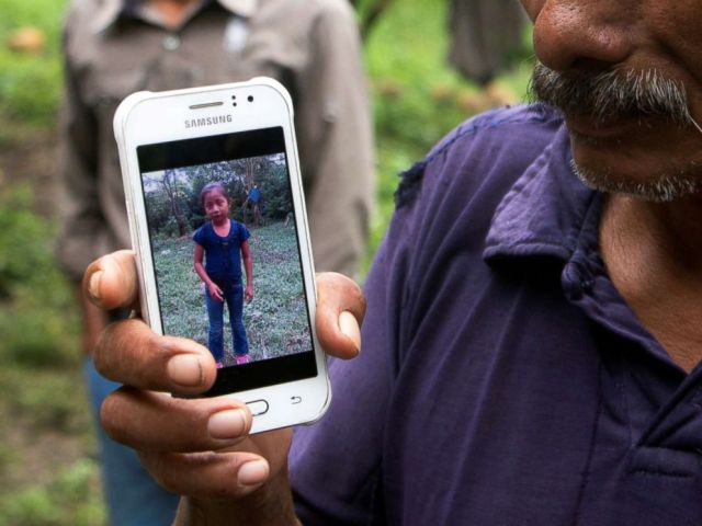 PHOTO: Domingo Caal, 61, grandfather of Jakelin, a 7-year-old girl who died in U.S. custody, holds his mobile phone with a picture of his granddaughter as he stands outside her house in Raxruha, Guatemala, Dec. 15, 2018.