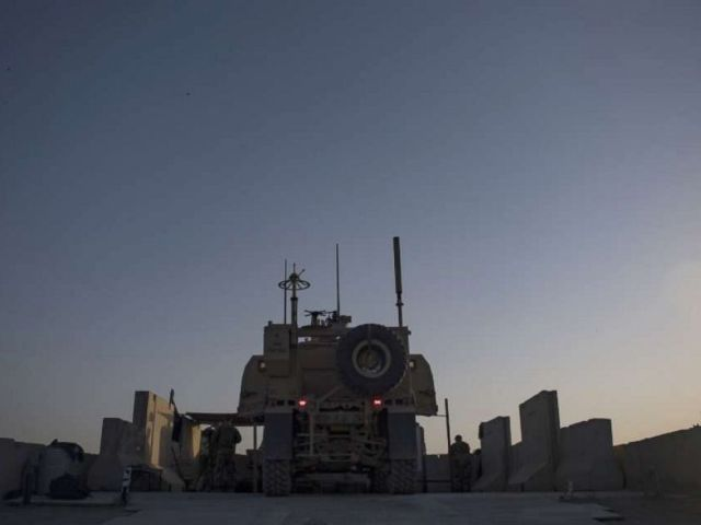 PHOTO: A security forces member from the 451st Expeditionary Support Squadron at Kandahar Airfield, Afghanistan, conducts perimeter sweeps of the base, Aug. 23, 2019.