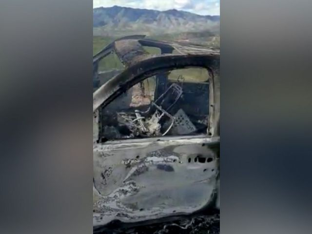 PHOTO: The burnt wreckage of a vehicle transporting a Mormon family living near the border with the U.S. is seen, after the family was caught in a crossfire between unknown gunmen from rival cartels, in Bavispe, Sonora, Mexico, Nov. 4, 2019.