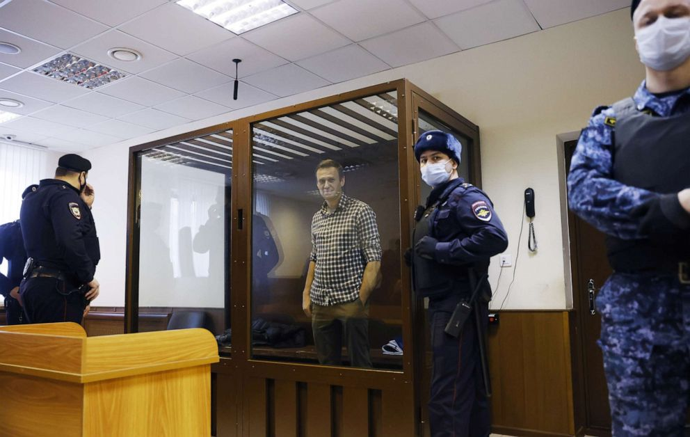 FILE PHOTO: Russian opposition leader Alexei Navalny attends a hearing to consider an appeal against an earlier court decision to change his suspended sentence to a real prison term, in Moscow, Russia February 20, 2021.