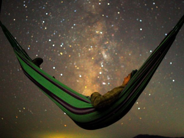 PHOTO: A girl lies in hammock as she looks at the milky way during the peak of Perseid meteor shower in Kozjak, Macedonia, Aug. 13, 2018.