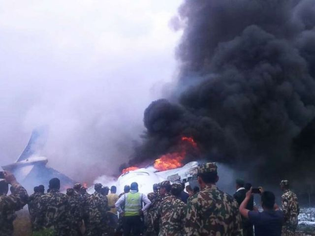 PHOTO: Authorities have rescued at least 17 passengers on a flight that landed in Nepal, skipped off the runway and burst into flames, March 12, 2018.