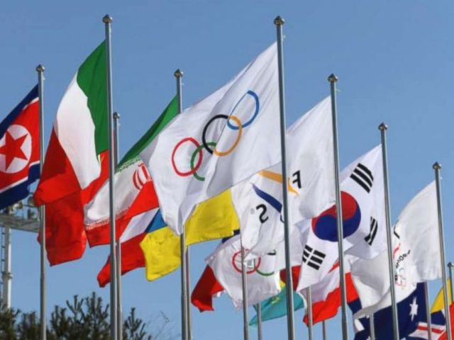 PHOTO:The Olympic flag surrounded by flags from various countries that are competing in the Winter Olympics, wave in the wind in front of the Olympic Stadium in Pyeongchang, South Korea, Feb. 7, 2018.