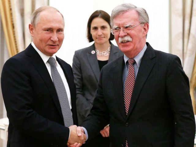 PHOTO: Russian President Vladimir Putin, left, and U.S. National security adviser John Bolton shake hands during their meeting in the Kremlin in Moscow, Oct. 23, 2018.