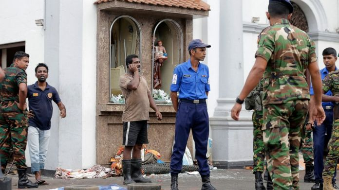 People gather in front of St. Anthony's Shrine, where an explosion took place on April 21, 2019 in Colombo, Sri Lanka. A hospital spokesman in Sri Lanka says several Easter Sunday detonations killed dozens of people.