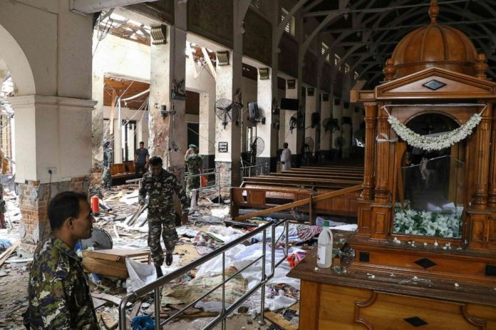 Sri Lankan security guard investigates the damage to St. Anthony's Shrine following an explosion in Colombo, Sri Lanka, on April 21, 2019.