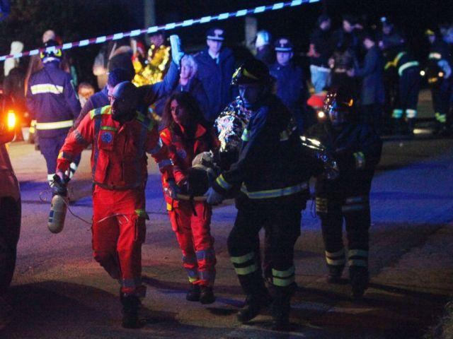PHOTO: Rescuers assist injured people outside the disco Lanterna Azzurra in Corinaldo, Italy, Dec. 8, 2018.