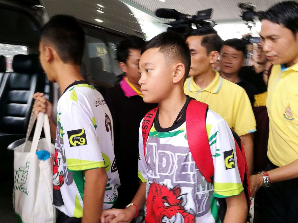 PHOTO: Two of the twelve rescued members of the Wild Boar soccer team depart from the Chiangrai Prachanukroh Hospital in Chiang Rai province, Thailand, July 18, 2018.