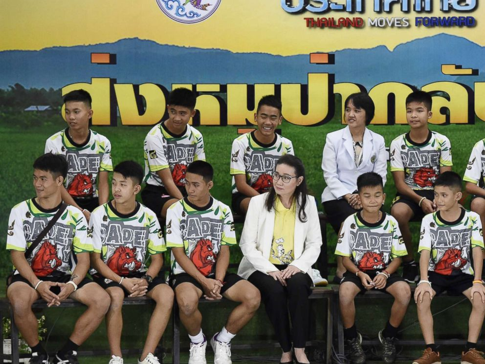PHOTO: Twelve Thai boys and their football coach, rescued from a flooded cave after being trapped, attend a press conference in Chiang Rai, July 18, 2018, following their discharge from the hospital.