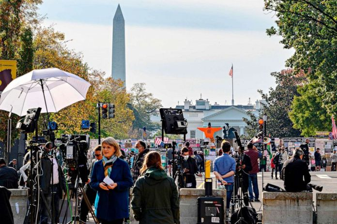 PHOTO: Journalists from all over the world wait for the result of the presidential election on Black Lives Matter Plaza in front of the White House on Nov. 6, 2020, in Washington.