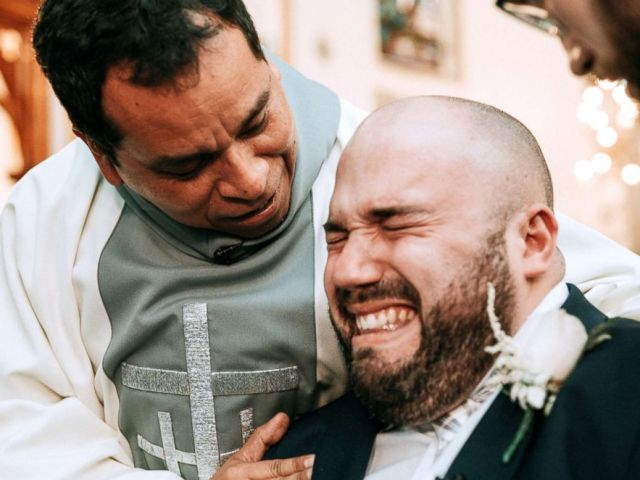PHOTO: Groom Justin Boisvert is consoled after he broke down into tears on his wedding day, April 20, 2018.