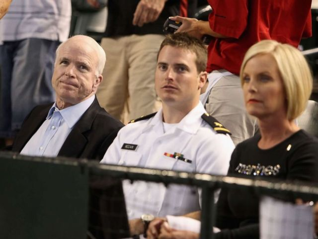 PHOTO: U.S. Sen. John McCain (R-AZ), U.S. Navy ensign Jack McCain and wife Cindy McCain attend the major league baseball game between the San Diego Padres and the Arizona Diamondbacks at Chase Field on May 25, 2009 in Phoenix, Arizona.