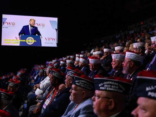 PHOTO: Audience members listen as President Donald Trump speaks during the Veterans of Foreign Wars of the United States National Convention,July 24, 2018, in Kansas City, Mo.