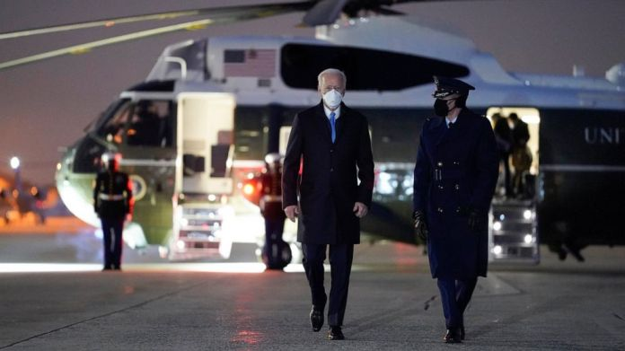 President Joe Biden walks to board Air Force One for a trip to Camp David, Friday, Feb. 12, 2021, in Andrews Air Force Base, Md. (AP Photo/Evan Vucci)