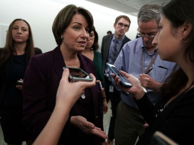PHOTO: Sen. Amy Klobuchar speaks to members of the media after Senate Judiciary Committee voted to approve, along party lines, the nomination of Judge Brett Kavanaugh to the Supreme Court, Sept. 28, 2018, on Capitol Hill in Washington, DC.