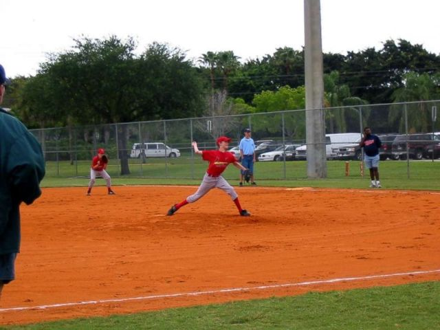 PHOTO: Andrew around age 12 pitching in little league game. He loved playing baseball prior to his diagnosis, and played from age 6 to 13.