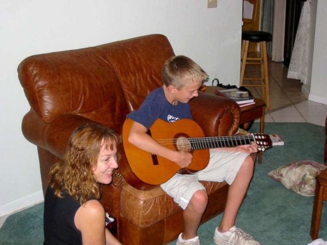 PHOTO: Andrew around age 11 playing guitar with his mom, Gayle, beside him. They started taking lessons together, and Gayle says Andrew still enjoys playing when hes well.