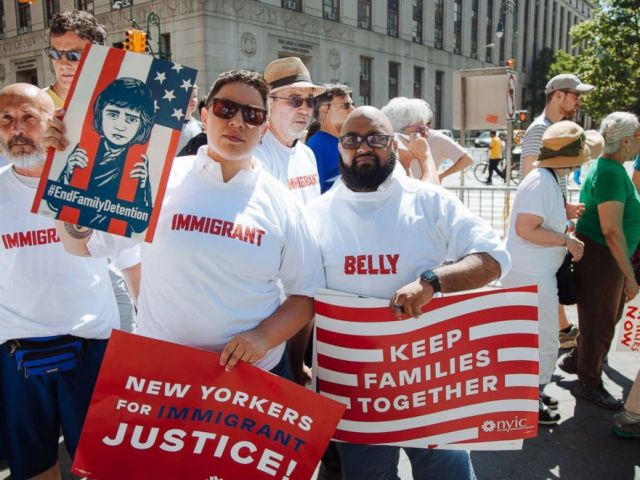PHOTO: Protestors wear Belly Immigrant T-shirts during an End Family Separation Rally & March in New York City.