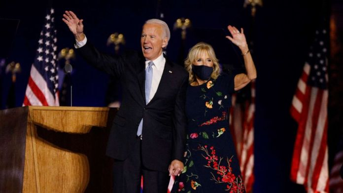 PHOTO: President-elect Joe Biden and his wife Jill wave to the crowd after speaking at his election rally, after the news media announced that Biden has won the presidential election, in Wilmington, Del., Nov. 7, 2020.