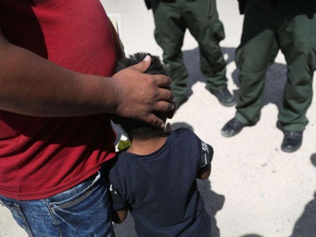PHOTO: U.S. Border Patrol agents take a father and son from Honduras into custody near the U.S.-Mexico border, June 12, 2018, near Mission, Texas.