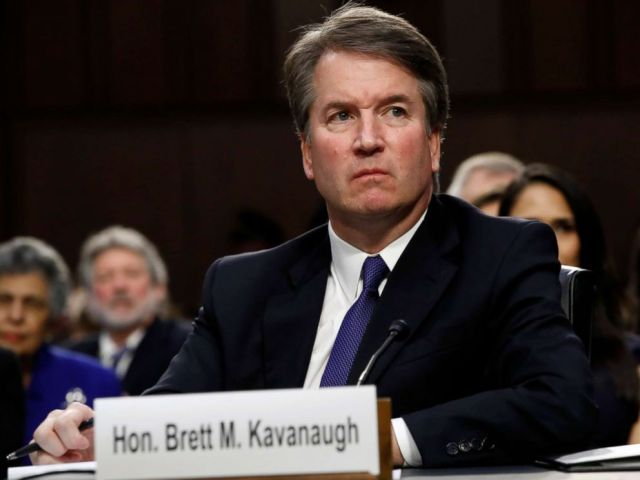 PHOTO: Supreme Court nominee Brett Kavanaugh listens as a protester yells during his confirmation hearing with the Senate Judiciary Committee on Capitol Hill, Sept. 4, 2018.