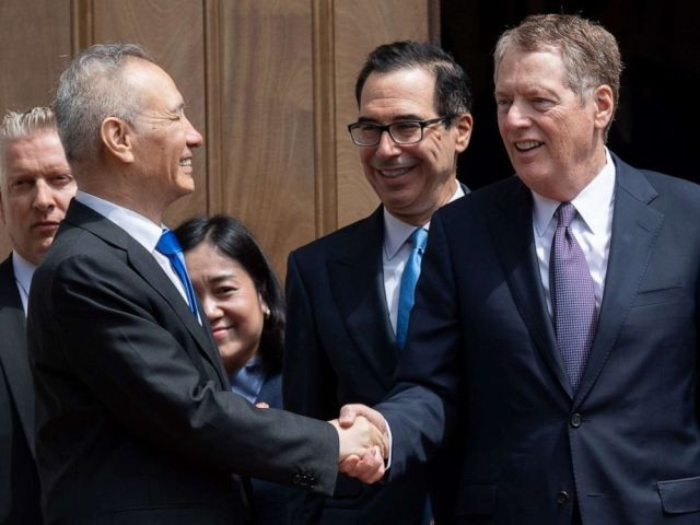 PHOTO: Chinese Vice Premier Liu He (L) shakes hands with US Trade Representative Robert Lighthizer (R) alongside US Treasury Secretary Steven Mnuchin (C) after trade negotiations in Washington, DC, May 10, 2019.