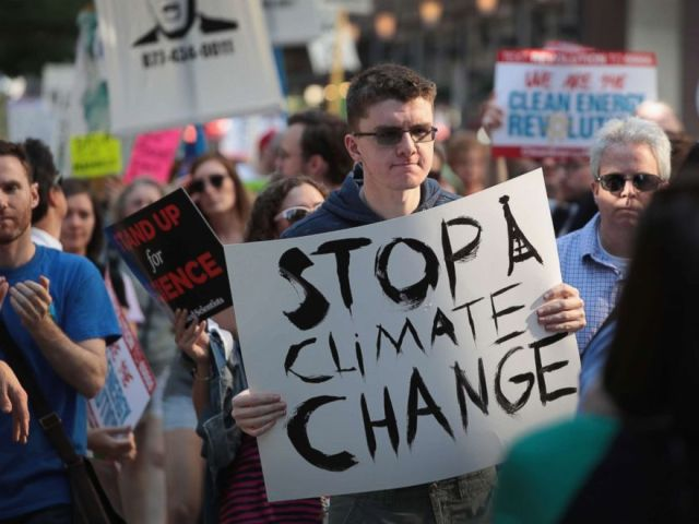 PHOTO: Demonstrators protest President Donald Trumps decision to exit the Paris climate change accord on June 2, 2017 in Chicago.