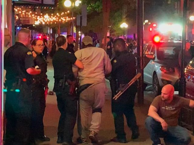 PHOTO: In this image made from video provided by Jeff Oaks, first responders help walk an injured person to safety after a deadly shooting in Dayton, Ohio, Aug. 4, 2019.