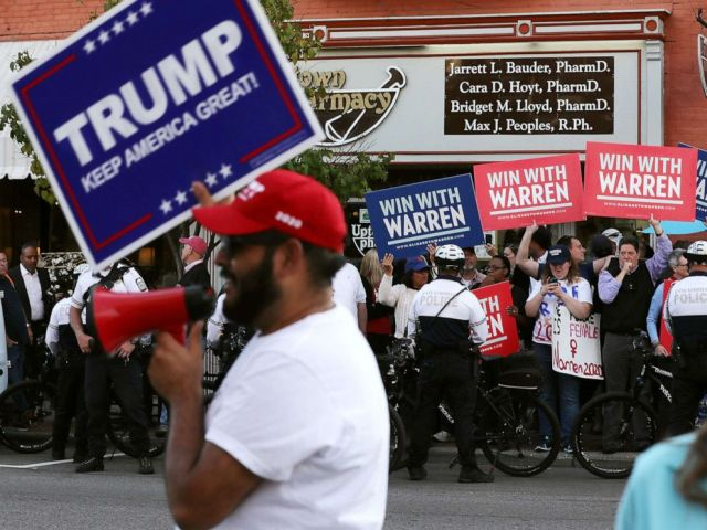 PHOTO: Supporters of resident Donald Trump and Sen. Elizabeth Warren rally on opposite corners near the perimeter of the fourth Democratic presidential debate Oct. 14, 2019 in Westerville, Ohio.