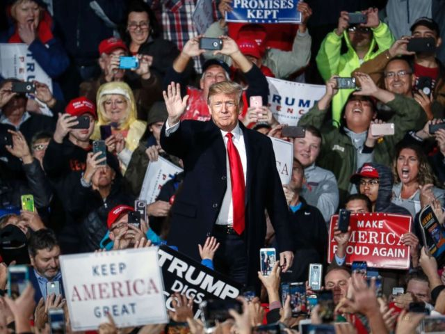 PHOTO: President Donald Trump waves to the crowd at a rally, Oct. 12, 2018, in Lebanon, Ohio.