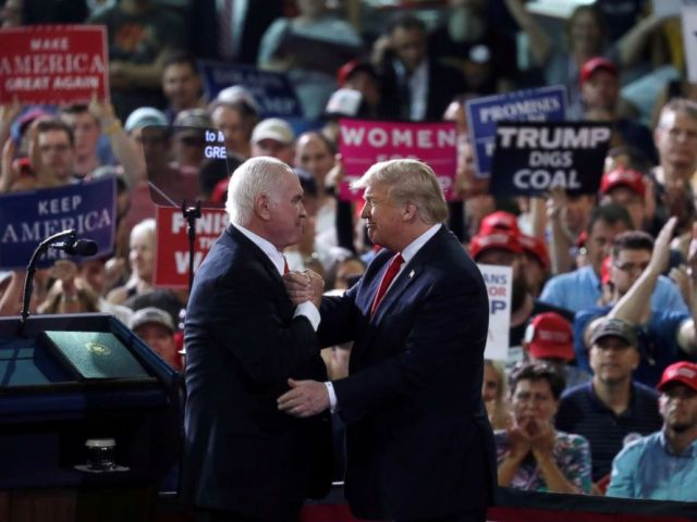 PHOTO: U.S. Rep. Mike Kelly, a Pennsylvania Republican nominee for the U.S. Senate, and President Donald Trump shake hands during a campaign rally in Erie, Pa., Oct. 10, 2018.