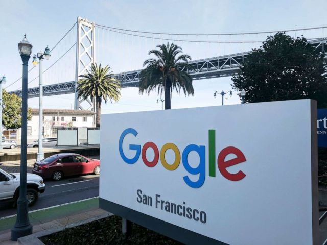 PHOTO: Signage outside the offices of Google in San Francisco with the San Francisco-Oakland Bay Bridge in the background.