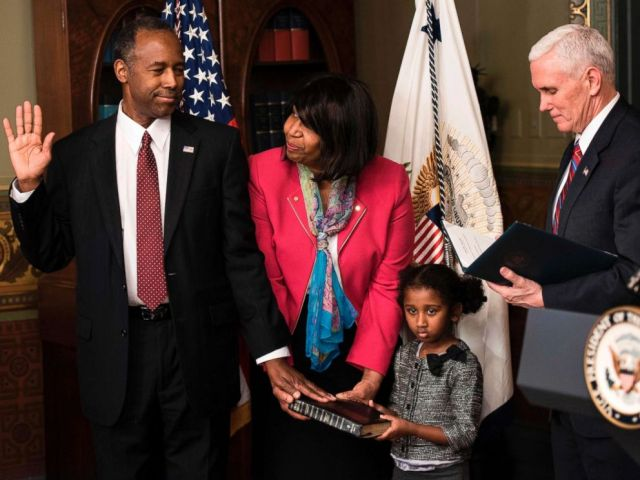 PHOTO: Ben Carson is sworn in as U.S. Secretary of Housing and Urban Development by Vice President Mike Pence (R) as his wife Candy Carson and granddaughter Tesora Carson watch during a ceremony, March 2, 2017. in Washington, D.C.