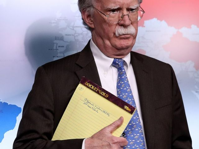 PHOTO: National Security Advisor John Bolton listens to questions from reporters during a press briefing at the White House, Jan. 28, 2019, while holding a legal pad with handwritten notes.