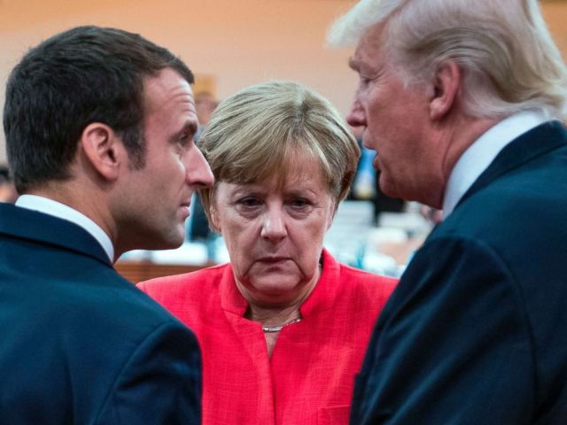 PHOTO: French President Emmanuel Macron, German Chancellor Angela Merkel and US President Donald Trump confer at the start of the first working session of the G20 meeting in Hamburg, Germany, July 7, 2017.