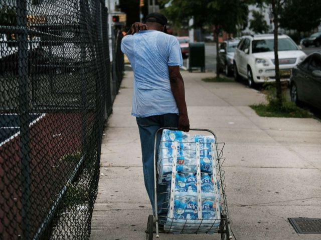 PHOTO: A resident takes bottled water home after receiving it at a recreation center, Aug. 13, 2019 in Newark, N.J., after lead was found in the tap water.